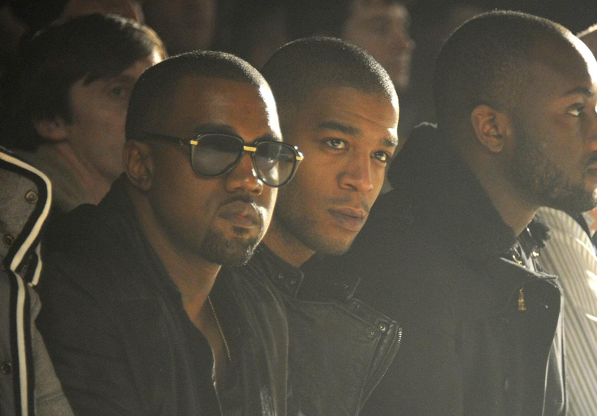 Kid Cudi and Kanye West front row at a fashion show