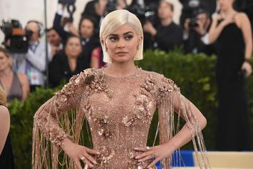 Kylie Jenner Poses In Calvin Klein Ad & Covers Her Belly