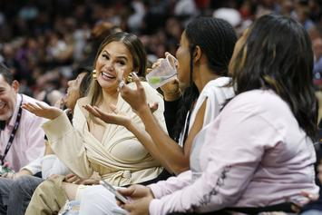 Chrissy Teigen & John Legend Soaked After Dwyane Wade Lands On Them During Game