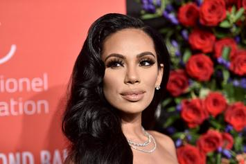 "Erica Mena Showcases Her Growing Baby Bump On Her Way To ""Overreact"""