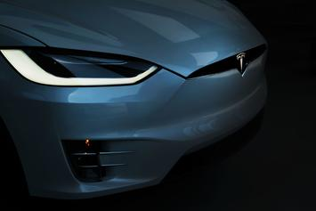 """Elon Musk Reveals British Talking Tesla: """"Don't Just Stand There Staring, Hop In"""""""