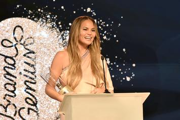 """Chrissy Teigen Mourns Her Breast Implants Post-Surgery With """"RIP"""" Boob Cake"""