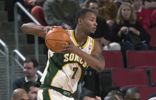 Forward Rashard Lewis #7 of the Seattle SuperSonics holds the ball during the NBA game against the Minnesota Timberwolves at Key Arena in Seattle, Washington on November 27, 2001. The Sonics won 112-102.