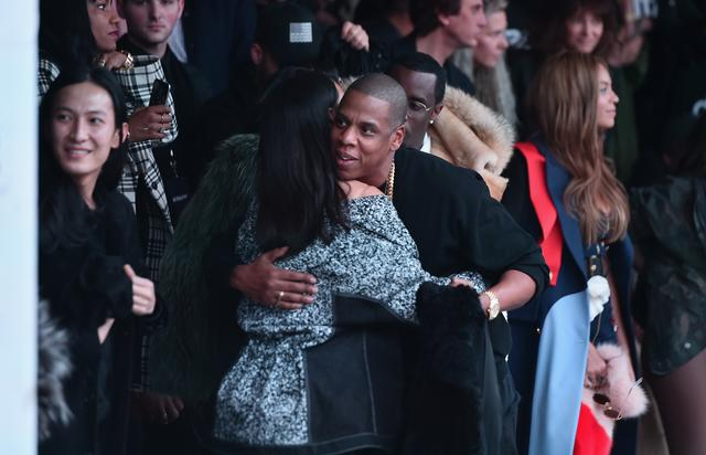 Jay Z giving Rihanna a hug