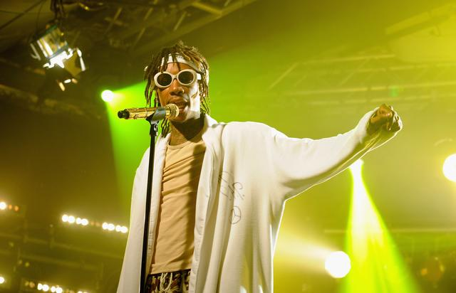 Wiz Khalifa performing in 2014