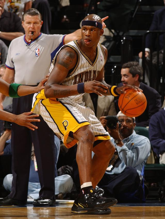 Al Harrington #3 of the Indiana Pacers posts up during the game against the Boston Celtics in Game 2 of the Eastern Conference Quarterfinals during the 2004 NBA Playoffs on April 20, 2004 at Conseco Fieldhouse in Indianapolis, Indiana. The Pacers won 103-90.