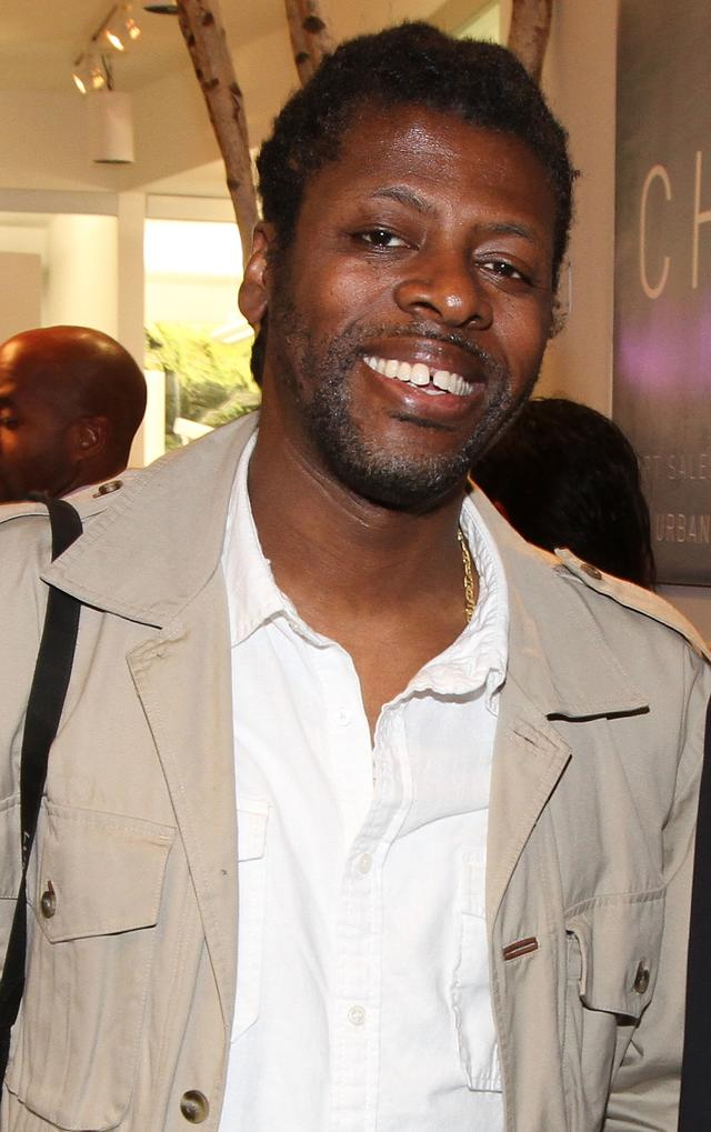 Chi Modu at his exhibit launch
