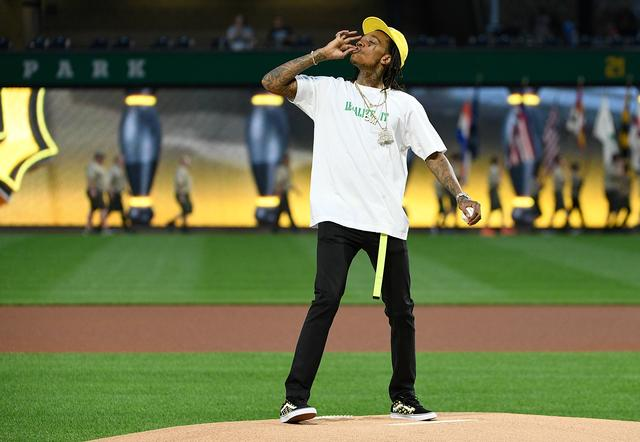 Wiz Khalifa hits a joint while doing the opening baseball pitch