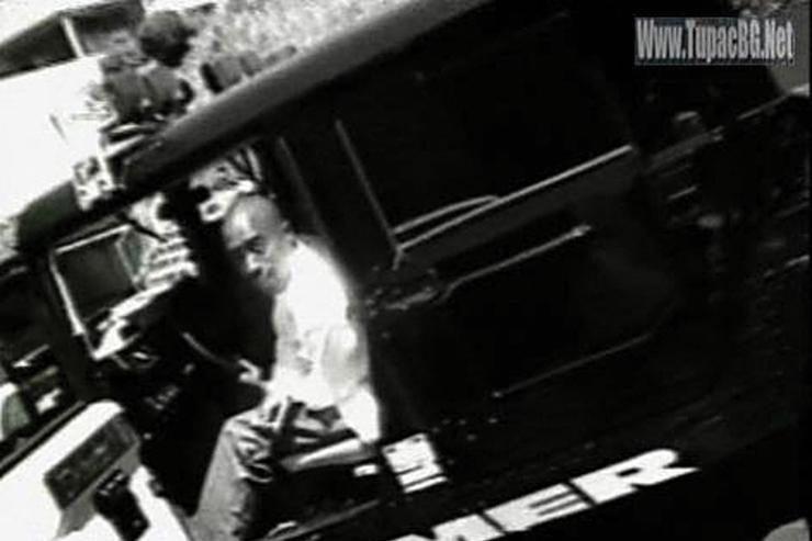 Image of Tupac in his H1 Hummer